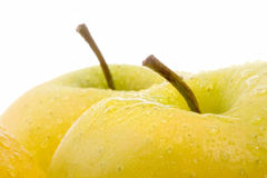 Golden delicious apple over white Royalty Free Stock Image