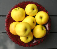 Golden Delicious Apples. A red glass bowl full of organic red delicious apples Royalty Free Stock Images