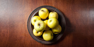 Golden delicious apples on a table above Royalty Free Stock Photos
