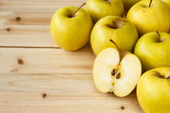 Golden delicious apples on a wooden background Stock Photo