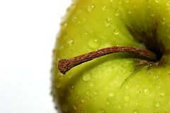 Golden Delicious with  Water Drops. Golden delicious apple and stem with water drops Stock Photo