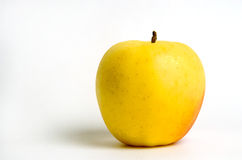 Golden Delicous Apple. A yellow golden delicous apple on a white background Stock Photos