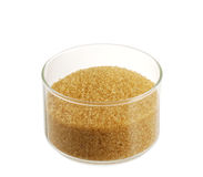 Golden demerara  sugar in glass bowl Stock Images