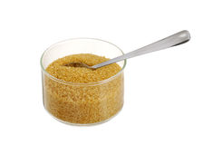 Golden demerara  sugar in glass bowl with teaspoon Stock Image