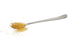Golden demerara  sugar spilled from teaspoon Stock Images