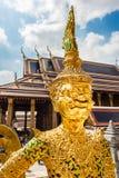 Golden demon. Details of Wat Phra Kaew, Temple of the Emerald Buddha, Bangkok, Thailand Royalty Free Stock Photography