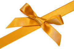 Golden  diagonal ribbone with bow,isolated Royalty Free Stock Photography