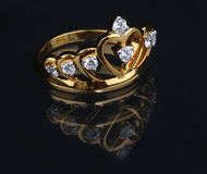 Golden diamond ring Stock Photography