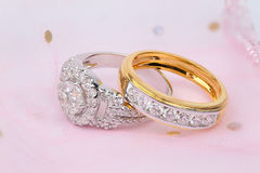 Golden diamond ring and contemporary diamond ring Stock Images