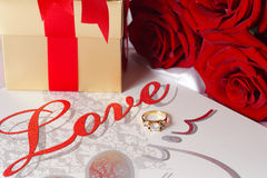 Golden diamond ring with gift box and red rose Stock Photo