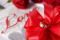 Golden diamond ring with gift box and red rose Stock Images