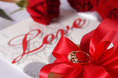 Golden diamond ring with gift box and red rose Royalty Free Stock Photography