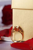 Golden diamond ring with gift box and red rose Stock Photography
