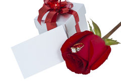 Golden diamond ring and rose, isolated background. Valentine Series Stock Photo