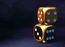 Golden dice background stock image