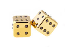 Golden Dice. Two golden dice with black diamonds isolated on white background Stock Images