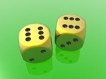 Golden dices. On green background Stock Photos