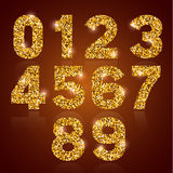 Golden digits set. Set of luxury golden digits with gold glitter texture, shiny and glowing. Vector illustration Royalty Free Stock Photo