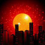 Golden disco ball over abstract cityscape. Gold 3D Disco Ball Over Dark Red Abstract Cityscape Background Stock Photography