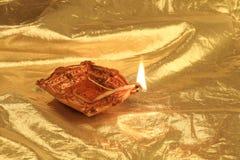 Golden Diwali - Handmade Diya in gold background stock photo