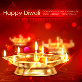 Golden diya stand on abstract Diwali background Stock Photos