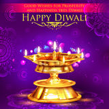 Golden diya stand on abstract Diwali background Royalty Free Stock Photo