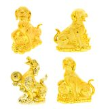Golden dog statue collection on white stock image