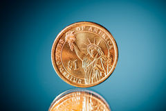 Golden dollar coin Royalty Free Stock Images