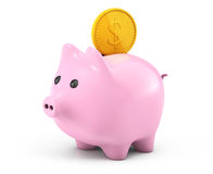 Golden dollar coin falling into a pink piggy bank Stock Photos