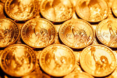 Golden dollar coins background Stock Photos