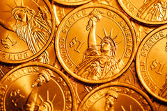 Golden dollar coins background Royalty Free Stock Photos