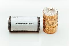 Golden dollar coins Stock Photos