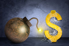 Golden dollar sign with bomb in spider net Stock Photo