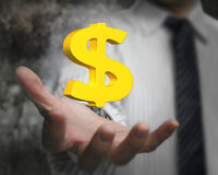 Golden dollar sign in business man's hand Stock Photography