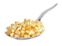 Golden Dollar Symbols on a Spoon Stock Image