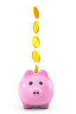 Golden dollars coins falling into a pink piggy bank Stock Images