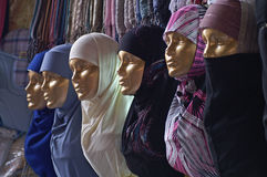 Golden dolls with a variety of headscarfs Stock Images