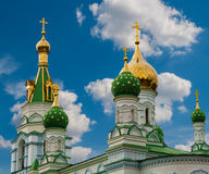 Golden dome of the church. Against the blue sky with clouds royalty free stock image