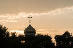 Golden dome of a church on a cloud background stock photo