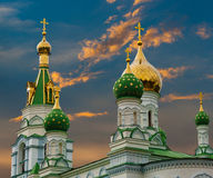 Golden dome of the church. Golden domes of the church on the sunset sky background stock photo