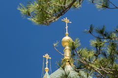 The golden dome and crosses of the Orthodox Church of the Holy Resurrection of Christ in Yalta near the place Baydarskie Gates. Crimea royalty free stock photography