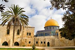 Golden Dome Mosque (Jerusalem). Tropical view of the Golden Dome Mosque, with palm and olive treest (Jerusalem, Israel Royalty Free Stock Photo