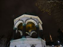 Golden dome at night with sky in the background stock photography