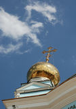 Golden dome of Orthodox christian temple. A shiny golden dome with a cross of orthodox christian temple 'Cathedral of sacred just soldier Feodor Ushakov' in royalty free stock image