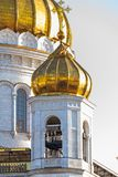 Golden dome of the Orthodox Church. With bell ringers, Orthodox cross on the top, Cathedral of Christ the Saviour in Moscow stock image