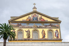 Golden dome with a roof of the Cathedral Church of the Basilica of St. Paul Fuori le Mura with the image of Jesus Christ and the H Royalty Free Stock Images