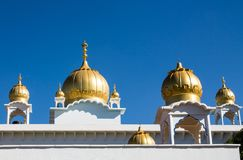 Golden dome on the roof of Sikh temple. Sikh temple golden domes on the roof in Makindu, Kenya. Sikhism religion. Guru Singh stock photography