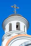 Golden dome of Russian orthodox church with cross Stock Photography