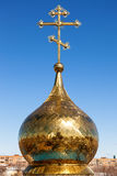 Golden dome of Russian orthodox church with cross Royalty Free Stock Photo