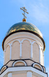 Golden dome of Russian orthodox church with cross Stock Photo